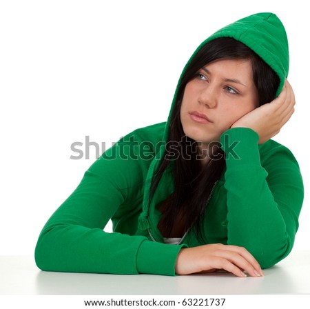 thoughtful, sad young woman in green sweatshirt with hood