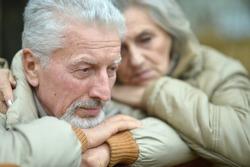 Thoughtful senior couple