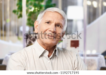 Thoughtful senior man at home #1192717195