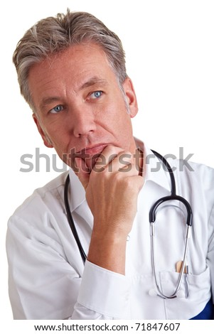 Thoughtful senior physician thinking with hand on his chin
