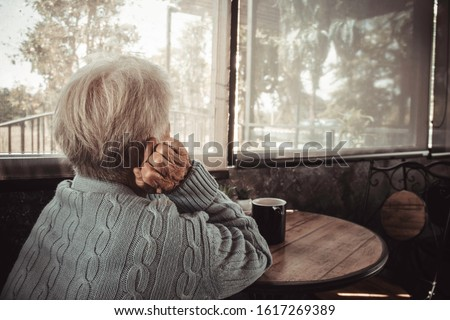 Thoughtful serious anxious mature senior woman feeling worried about problems. Concept dramatic loneliness, dementia, abuse, sadness, depression, sad emotions, cry, disappointed, healthcare, pain.
