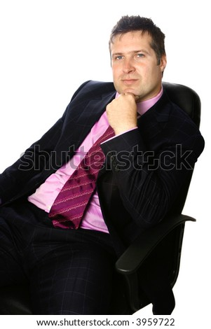 Thoughtful smart businessman with hand resting gently on chin, while seated in his office chair, isolated on white.