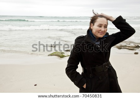 Thoughtful woman looking calm and serene while on beach.