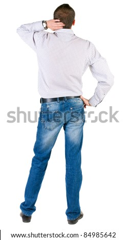 thoughtful young man. Rear view. isolated over white. - stock photo