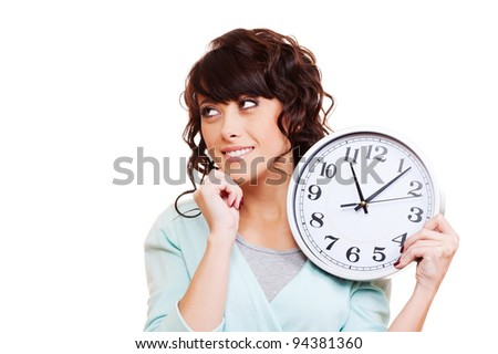 thoughtful young woman holding clock. isolated on white background