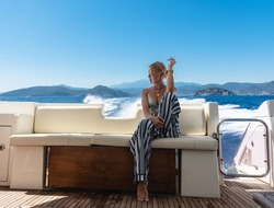 Thoughtful young woman observe beautiful sea water during cruise at yacht