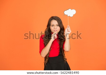 thoughts about future. smart child with party cloud. pretty thoughtful kid long curly hair. have your opinion. what on your mind. think of fashion. her thoughts. never know what she is thinking about.