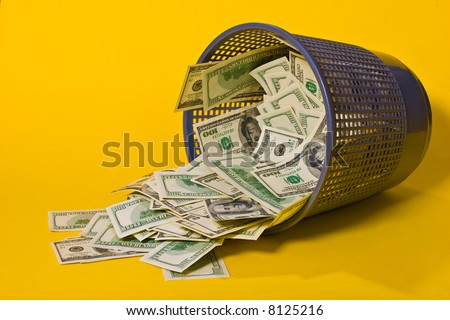 thousand dollars in the trash can, inflation - stock photo