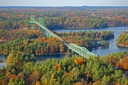 Thousand Islands Bridge across St. Lawrence River in fall in Thousand Islands National Park. This bridge connects New York State in USA and Ontario in Canada near Thousand Islands.
