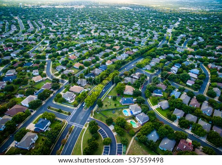 Thousands of houses aerial birds eye view suburb housing development new neighborhood in Austin , Texas , USA modern architecture and design