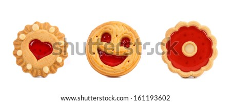 Thre different cookies with jam in row. Isolated on a white background.