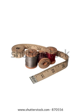 Thread and Measuring Tape - stock photo
