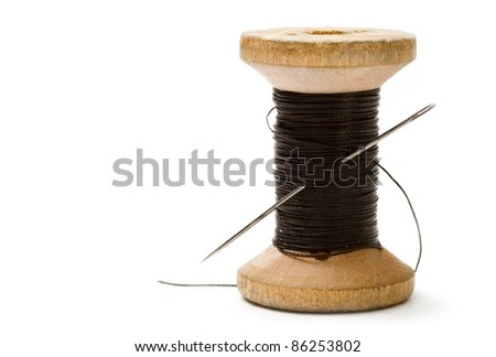 Thread bobbin isolated on white background