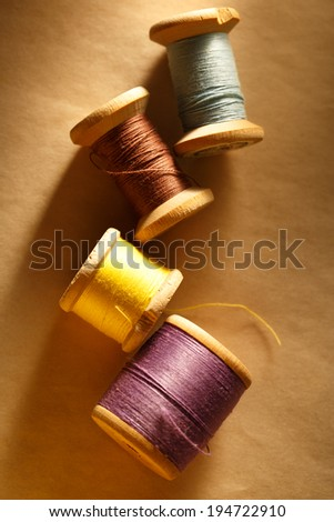 Thread bobbins on paper background