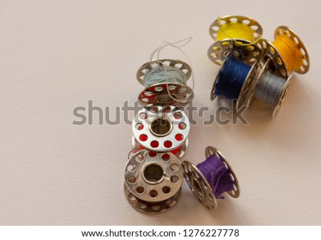 Thread on sewing machine bobbins showing concept of handmade