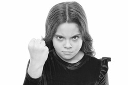 Threatening with physical attack. Kids aggression concept. Aggressive girl threatening to beat you. Dangerous girl. You are warned. Girl kid threatening with fist isolated on white. Strong temper.