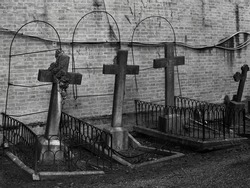 Three abandoned graves at old cemetery.