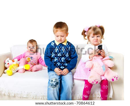 three adorable kids sitting on the sofa