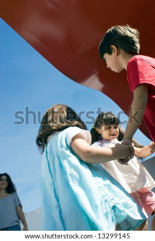 stock photo : Three adorable little kids (siblings) holding hands and