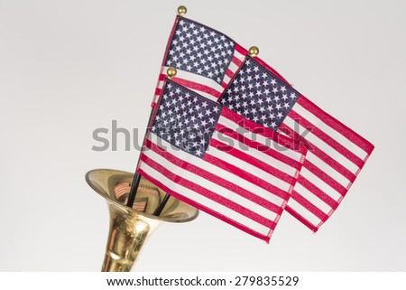 Three American Flags erupt from the bell of a trumpet in patriotism image