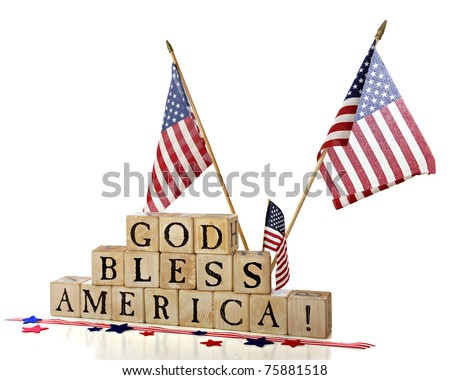 "Three American flags flying over rustic alphabet blocks that spell out ""God Bless America"".  Isolated on white."