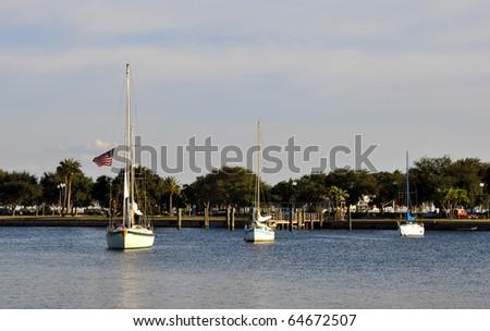 Three anchored sailboats at the St. Pete Bay, Florida