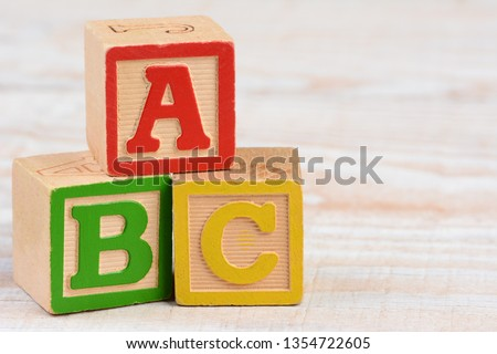 Three antique Childrens Alphabet Blocks stacked in ABC order