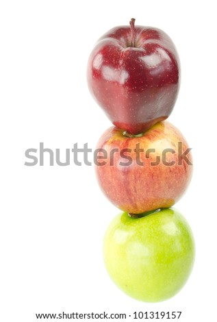 Three apples balanced on in a stack.