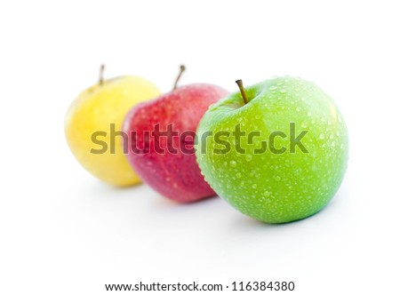 Three apples, green, red and yellow - stock photo