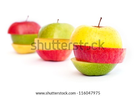 Three apples, green, red and yellow cut in slices