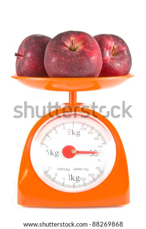 three apples lying on weight scale - stock photo