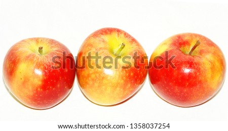 Three apples on white background #1358037254