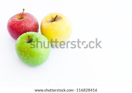 Three apples, red, green and yellow