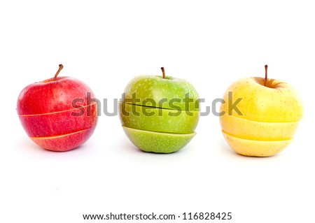Three apples, red, green and yellow cut in slices