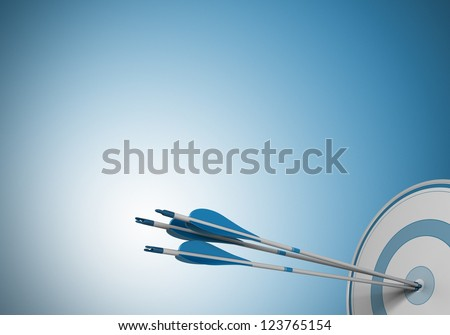 three arrows hitting the center of a target. Image over a blue background with free space for text