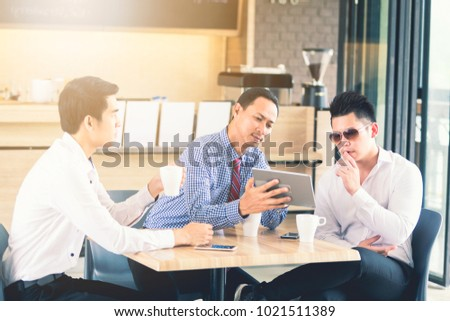 Three Asian businessmen talk about coffee #1021511389