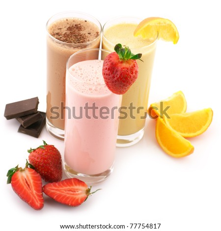 Three assorted protein cocktails with fruits isolated on white background.