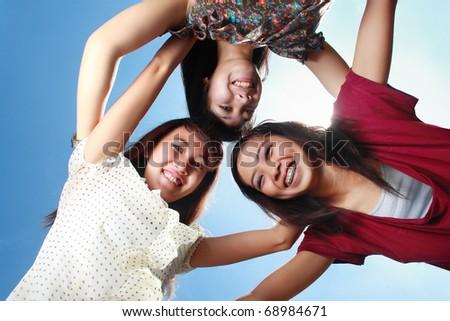 three attractive girl friends having fun outdoor - stock photo