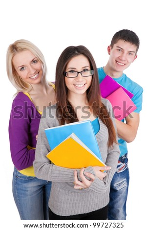 Three attractive students looking at camera on a white background