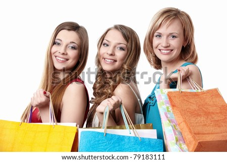 Three attractive young women with bag isolated
