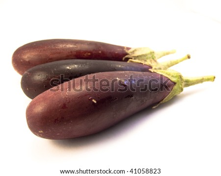 Three aubergine shot from the side on a white background - stock photo
