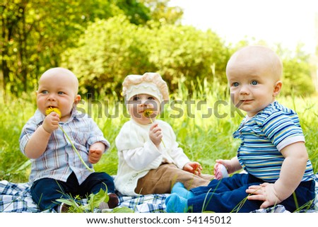 Three babies in the spring park