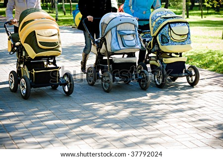 three baby carriage in park