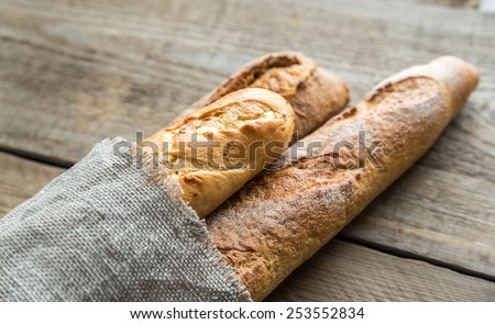 Shutterstock Three baguettes on the wooden background