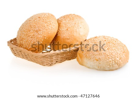 Three Baked Buns with Sesame in Basket Isolated on White Background