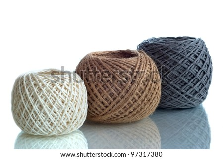 Three  balls of twine on a white background