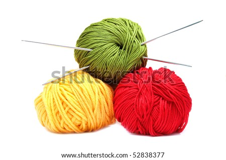 Three balls of wool with knitting needles isolated on white background