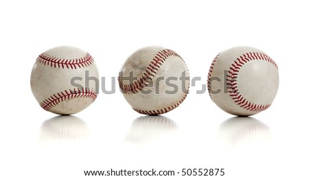 Three baseballs with red thread on a white background