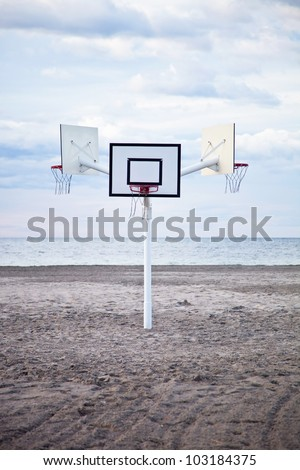 three basketball hoops on the beach