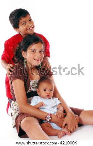 Three beautiful biracial siblings isolated on white.